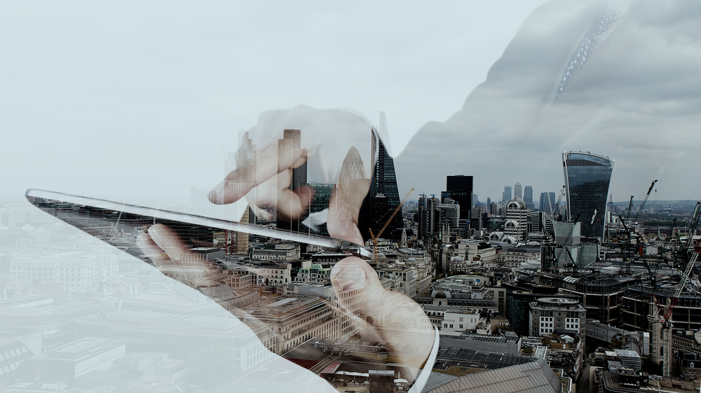 Double exposure of businessman working with new modern computer and london city background as concept-2